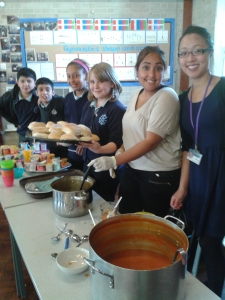 Pupils and staff serve lunch to the wider school community