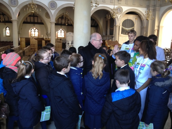Eric Pickles MP answering questions on climate change from young CAFOD supporters at Brentwood Cathedral]