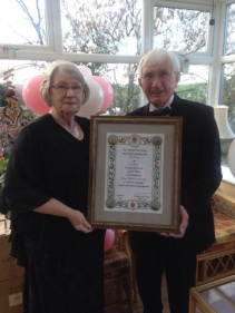 Bill and Ann Hurley holding their Papal Blessing.