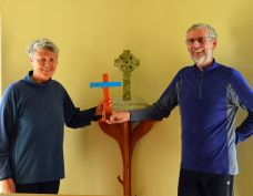Martin and Libby hand the Lampedusa Cross to Iona