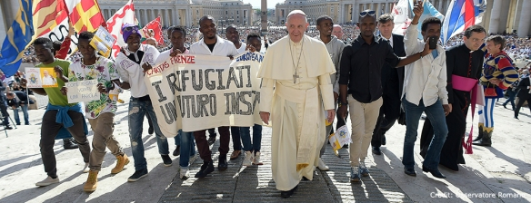 StJ Pope+with+refugees+in+Rome+banner+credit